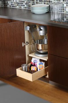 Urban Loft - Storage Solutions  Mixer storage in a cabinet that lifts up to it's own little stand.  Wonder if I could install this in the kitchen?