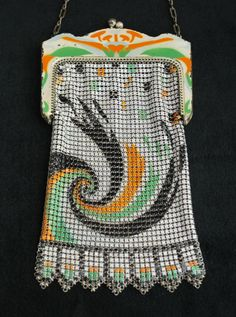 Art Deco pattern mesh bag with both the El Sah and Whiting and Davis Company metal tag still attached. Referred to as a swirl of feather pattern in the Pina and Johnson book,