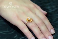 Diamond Engagement Designer Flower Ring 0.27ct 18K Gold, Total 0.35ct #ME7004  Ring specification: Metal type: Gold Metal purity: 18k Metal Weight: 6.5gram  💎 💎 💎 💎 💎 💎 💎 💎 Center Stone Shape: Round Cut Carat Weight: 0.27ct Color: G Clarity: VS2  💎 💎 💎 💎 💎 💎 💎 💎 Side Stones Shape: Round Cut Carat Weight: 0.8ct Total Color: G Clarity: VS  Certification By IGL- International Gemological Laboratory