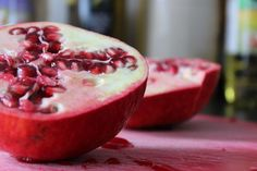 #blood #cutting board #fresh #fruit #pair #pomegranate #red