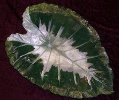 Painted cast concrete leaf.