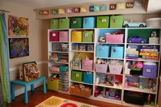 this family uses their formal dining room for their play room....i love how they have their storage set up!