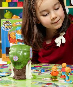 The Berenstain Bears Tales to Play Game. The fuzzy family comes to life with colorful characters, the classic tree house & a fun dice-rolling race. Every bitty bear will love traveling around the board causing trouble & making up for it as they explore the Berenstain Bears' world in this exciting game. Includes 4 pawns, 4 house dice slide, die, 16 trouble cards, 16 nice cards, game board & rules 2 to 4 players. Ages 3 & up $13.99