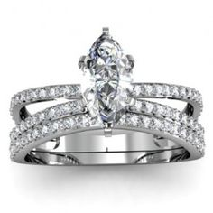I love the Marquise with the band set up! I would love to see what it would look like with a round Tiffany set solitaire!