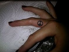 Makes me think of my peace sign tattoo just like this on the inside of my ankle. My favorite tattoo :)