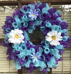 Turquoise and purple spiral deco mesh wreath with flowers.