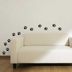 This unique design features a set of cat paw prints that can be placed on the wall to look like a cats walking path. 12 dog paw prints are