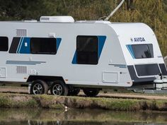 This is the Avida Emerald CV5934QB Tourer with Indigo Mist coloured decals - one of 13 decal colour choices available.