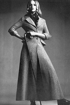 Maudie James in mist pink Harris tweed long coat, wasp-waisted with a butterfly peplum hiding pockets by Ossie Clark, Vogue UK, October 1968.
