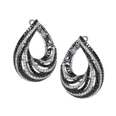 Black and white diamond bypass hoop earrings.     2326 Collection by San Antonio Jewelry (210)493-7789 sajewelry.com