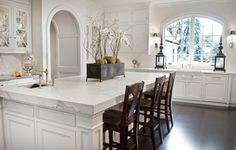 arched doorway, subway, floors, extra thick marble on the island