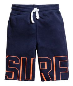 Dark blue. Long sweatshorts with a printed design. Elasticized drawstring waistband, side pockets, and raw-edge hems.