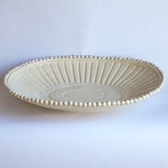 "Frances' design notes: I find this shape especially versatile - sometimes you need a low bowl, sometimes a cocooning platter. It is a form that will get lots of use. Dimensions: 16.75"" x 12.5"""