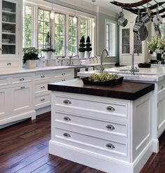 Van Dykes' vendor, Berenson, provides the knobs and pulls to this classic kitchen.