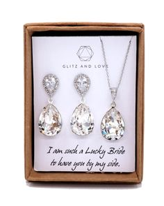 Clear Swarovski Crystal Teardrop (13mm x 18 mm) in Sterling Silver plated closed back settings. Cubic zirconia Teardrop earrings, Luster Rhodium plated. Cubic zirconia bail, Luster Rhodium plated. 925 sterling silver ear posts. Nickel Free.  ✦ Earrings: 1.2 inch ✦ Necklace Length: 16.5 inch + 2 inch extender  MESSAGE: - CUSTOM NOTE IN BOX: please let me know during check out; or - Choose one of the pre-printed cards (last picture)[Outside box]  ✦ Please let me know your EVENT date in the…