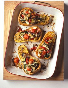 A really attractive autumn recipe with sweet butternut squash halves stuffed with roasted vegetables and goat's cheese and finished with a scattering of breadcrumbs to make little eat-all vegetable gratins.