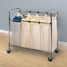 LAUNDRY ROOM – Another great design idea for a well-functioning laundry room. Laundry sorter with 4 removable canvas bags and castered steel frame.