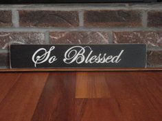 So Blessed sign done in black with cream lettering