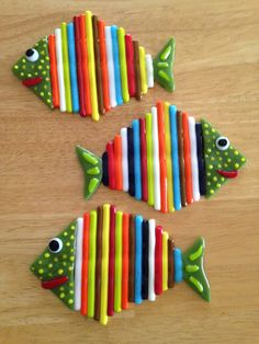 """Just out of the kiln - Rainbow fish by Kim Natwig. 4"""" by 6"""" soft fused rods, frit, and scrap glass."""