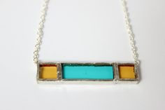 Yellow & Teal glass with nickle-free, sterling silver chain in a lead-free…
