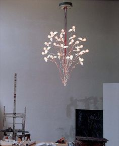 Birds birds birds chandelier by Ingo. This pendant light features 24 bulbs that have wings on them as though to appear they are in flight. This by far is one of the most unique designs to date. Tin-plated metal parts and cables are available in transparent or red/blue. #modernlighting #chandeliers
