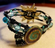 Bracelet by Lisa Powell with Clayworks Stoneware Swirl Button Closure.