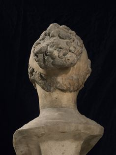 Marble head of girl set into modern bust.