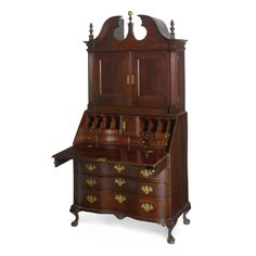 A Chippendale Carved Cherrywood Reverse-Serpentine Bonnet-Top Slant-Front Desk-and-Bookcase, Connecticut circa 1785 Appears to retain its original hardware and finials. Height 84 1/4 in. by Width 40 1/2 in. by Depth 22 1/4 in.