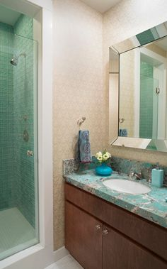 Turquoise countertops and tiled shower give the master bath a spa-like feel  - Traditional Home®    Photo: Joe Standart