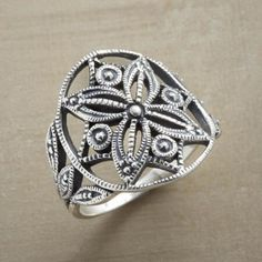 MANDALA RING - Expert silversmiths display their art in this sterling silver ring bearing a mandala, the ancient symbol of the universe.