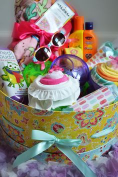 """I am so excited in the way my new """"Summer Fun Basket"""" turned out. It has everything that any little girl would need for a fun and safe summer.  Check out www.alamode-gifts.com for full details and a list of everything in this beautiful basket. $100"""