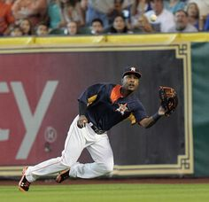 L.J. Hoes #28 of the Houston Astros makes a diving catch on a line drive hit by Adrian Beltre #29 of the Texas Rangers in the second inning at Minute Maid Park on August 11, 2013 in Houston, Texas. (Photo by Bob Levey/Getty Images)