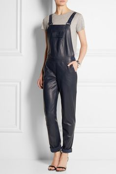 RICHARD NICOLL.  Leather overalls //Richard Nicoll's navy overalls have been meticulously crafted from buttery leather. The loose silhouette is given a feminine update with its softly tapered leg and low-cut back. Layer yours over a checkered vest – as styled for the Resort '15 collection - or a simple tee.