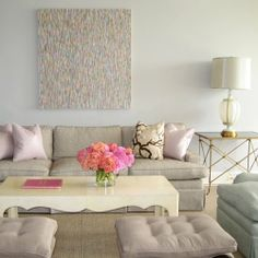1. Keep the pastels cool and pale and use them in a field of warm neutrals. This example has pastel pinks an turquoises but the creamy white lacquered table, gold toned metal accents and warm beige rug and sofa make the icy pastels stand out and look fresh and interesting.