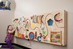 Amazing sensory wall in order to develop tactile sense and also to teach math #SensoryActivities #MathGames #Montessori #DIY