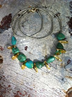 Hey, I found this really awesome Etsy listing at http://www.etsy.com/listing/162325088/modern-tribal-necklace-turquoise-nugget