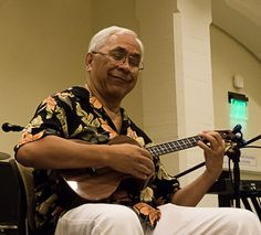 "Pure Bliss ! Kimo Hussey playing a custom Lichty Ukulele.  We called him ""Uncle Billy!""  He sang to our Mom and my Sister!!!!"