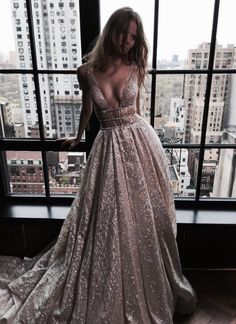 This has to be one of the most beautiful dresses I have ever seen! I'm in love with this dress!