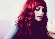 How I Lost Half of Me But Became Whole: Long, red hair...
