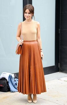 A pleated maxi skirt and tank top, all done in neutral colors - you're looking at 1/30 of Miroslava Duma's best outfits