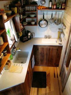 Travis Pyke and wife Brittany are a husband and wife tiny house living couple who built this 204 sq. ft. on wheels. They call it the Wind River Bungalow. Here's the perfect, space-efficient kitchen. | Tiny Homes