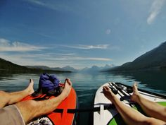 Stephan Ferry and Jessie Mazur enjoy a peaceful morning in Glacier National Park on their inflatable SUPs.