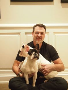 Bob Williams with his French bulldogs Violet (in front, with dark face) and Lily