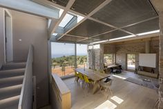 stone residence located in Mani, Peloponnese, Greece, was designed by HHH Architects.