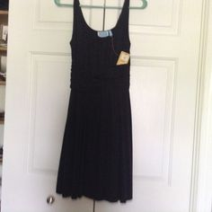 """Black midi  dress Brand new with tags black mini dress. Blouson type  95% viscose 5%lycra   Very soft with some stretch. Bought at a cute boutique hits top of knees   I'm 5'4"""" Survival  Dresses Midi"""