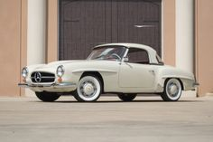 This 1961 Mercedes-Benz 190SL is good driver quality example wearing an older restoration. White with red interior and 2 tops. It runs and drives well and is very presentable. A smart buy at just $87,500 #gullwingmotorcars #classiccars #buy&sellclassiccars #VintageCarBuyer #ClassicCar  #antiqueCarBuyer #1961Mercedes-Benz190SL #Mercedes-Benz190SL #190SL m#Mercedes-Benz