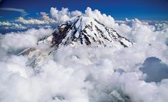 Mount Rainier, Washington  Mount Rainier is the most heavily glaciated peak in the lower 48 states, with ice and snow covering 35 square miles. The 14,410-foot peak was named in 1792, when British explorer Capt. George Vancouver named it after a friend of his, Rear Adm. Peter Rainier.