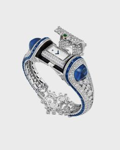 with · · · A dream bracelet of Van Cleef&Arpels with a secret watch 💙⏰ Van Cleef&Arpels'ın gizli saati ile süslenen harika bileziği💙⏰ Van Cleef And Arpels Jewelry, Amazing Watches, Beautiful Watches, High Jewelry, Luxury Jewelry, Jewellery, Timex Watches, Expensive Watches, Luxury Watches