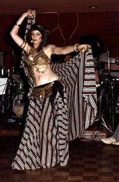Vintage Orientale/American Orientale belly dance costume. Looks like a costless coin set. The striped skirt/veil were in style a lot in the 70s/80s