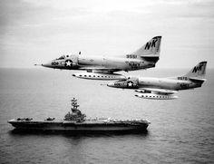 2 A4 Skyhawks from USS Constellation CVA-64 fly past USS Kearsarge CV-33 in Gulf of Tonkin, August 1964.